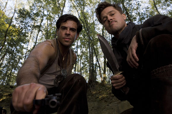 hoto Caption: Lt. Aldo Raine (Brad Pitt) and Sgt. Donny Donowitz (Eli Roth) in Quentin Tarantino's Inglourious Basterds. Photo: Francois Duhamel/ TWC 2009.